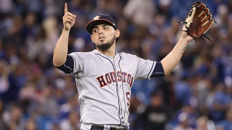 Roberto Osuna of the Houston Astros celebrates after getting the final out of the game during MLB game action against the Toronto Blue Jays at Rogers Centre on September 24, 2018 in Toronto, Canada. (Photo by Tom Szczerbowski/Getty Images)