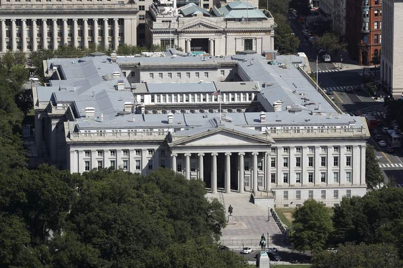 FILE - The U.S. Treasury Department building viewed from the Washington Monument, Wednesday, Sept. 18, 2019, in Washington. Hackers got into computers at the U.S. Treasury Department and possibly other federal agencies, touching off a government response involving the National Security Council. Security Council spokesperson John Ullyot said Sunday, Dec. 13, 2020 that the government is aware of reports about the hacks. (AP Photo/Patrick Semansky, file)