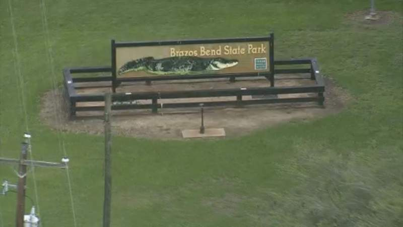 The sign for Brazos Bend State Park near Lochridge, Texas, is seen from the air on April 7, 2020.