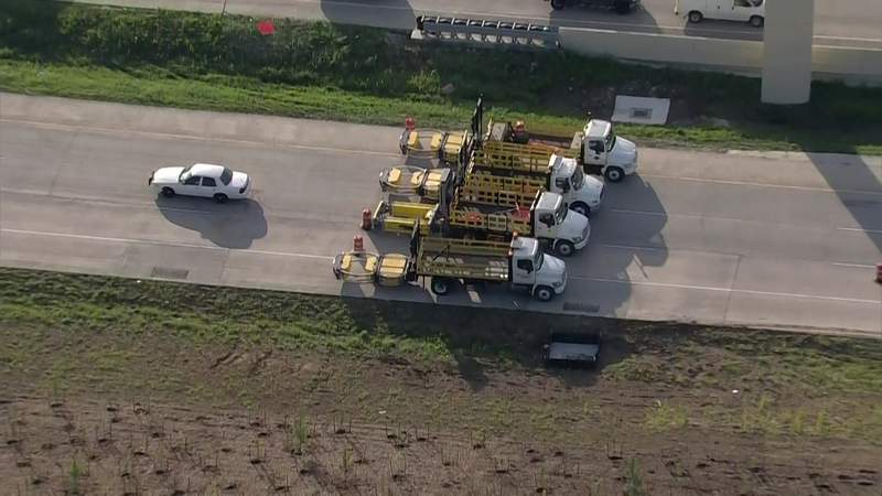 Crash-prevention vehicles block a section of SH 288 in Houston on April 19, 2021.