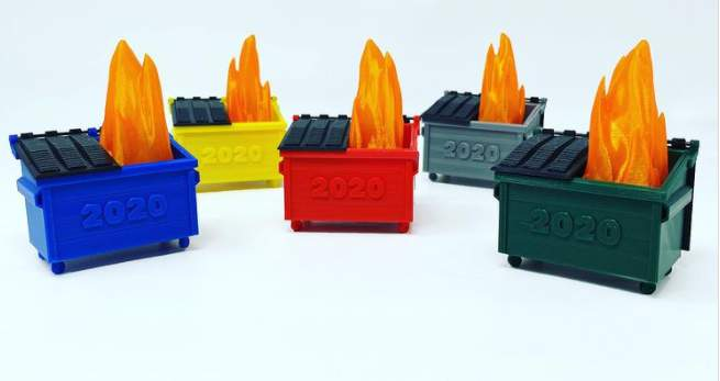 Various colored versions of the 2020 Dumpster Fire toy by RexRoi3D