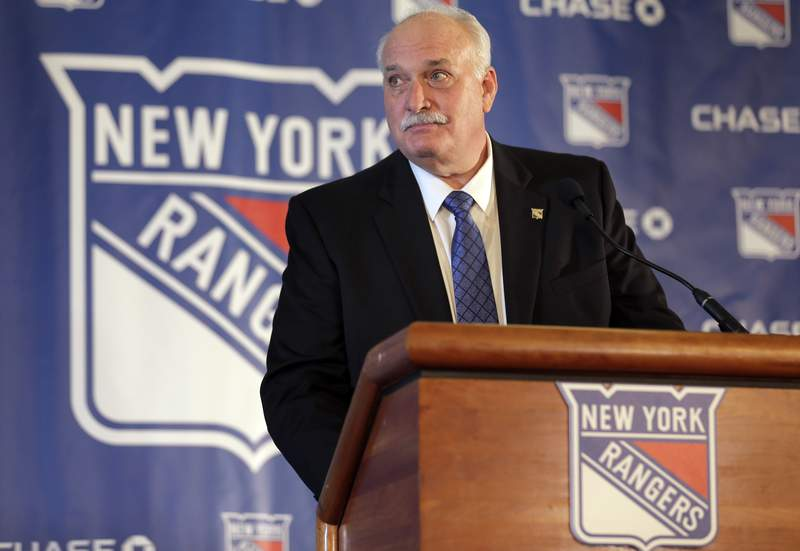 FILE - John Davidson, the new president of the New York Rangers, speaks during a news conference in New York, in this Wednesday, May 22, 2019, file photo.  The New York Rangers abruptly fired president John Davidson and general manager Jeff Gorton on Wednesday, May 5, 2021 with three games left in the season. Chris Drury was named president and GM. He previously served as associate GM under Davidson and Gorton.  (AP Photo/Seth Wenig, File)