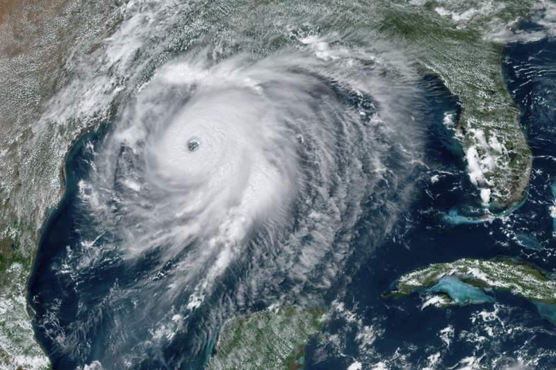 """This GOES-16 GeoColor satellite image taken Wednesday, Aug. 26, 2020, at 2:40 p.m. EDT., and provided by NOAA, shows Hurricane Laura over the Gulf of Mexico. Hurricane Laura strengthened Wednesday into an extremely dangerous Category 4 hurricane,"""" The National Hurricane Center said.  Laura is expected to strike Wednesday night into Thursday morning along the Louisiana-Texas border. (NOAA via AP)"""