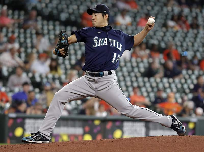HOUSTON, TEXAS - APRIL 29: Yusei Kikuchi #18 of the Seattle Mariners pitches in the first inning against the Houston Astros at Minute Maid Park on April 29, 2021 in Houston, Texas. (Photo by Bob Levey/Getty Images)