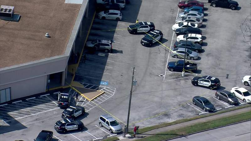 Police investigate a shooting that happened in the parking lot of a strip mall in northwest Houston on Oct. 13, 2020.
