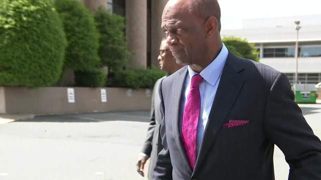 Kirbyjon Caldwell walks out of federal court in Louisiana. (File)