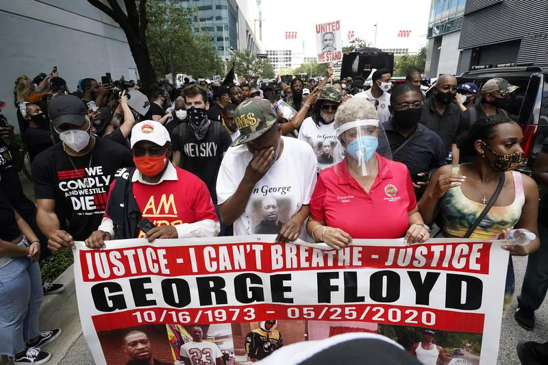 LaTonya Floyd, third from left, participates in a march to protest the death of her brother, George Floyd in Houston on Tuesday, June 2, 2020. Floyd died after a Minneapolis police officer pressed his knee into Floyd's neck for several minutes even after he stopped moving and pleading for air. (AP Photo/David J. Phillip)