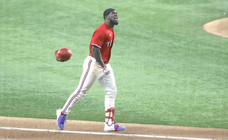 Adolis Garcia #53 of the Texas Rangers celebrates his three run walk-off home run against the Houston Astros during the tenth inning at Globe Life Field on May 21, 2021 in Arlington, Texas. The Rangers won 7-5. (Photo by Ron Jenkins/Getty Images)