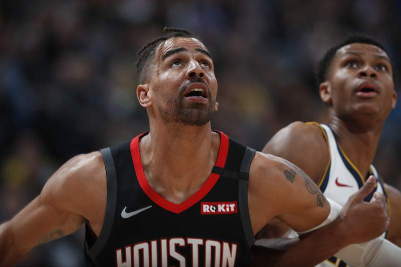 FILE - In a Sunday, Jan. 26, 2020 file photo, Houston Rockets forward Thabo Sefolosha (18), left, and Denver Nuggets guard PJ Dozier (35) in the second half of an NBA basketball game, in Denver. Time has not healed all wounds for Sefolosha, the NBA veteran who says he was attacked by a group of New York Police Department officers in April 2015 while they were arresting him outside a nightclub in the citys Chelsea neighborhood.  (AP Photo/David Zalubowski, File)