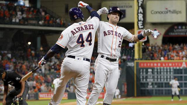 Alex Bregman celebrates with Yordan Alvarez after Bregman's two-run home run in the fourth inning against the Detroit Tigers at Minute Maid Park on August 22, 2019, in Houston, Texas.
