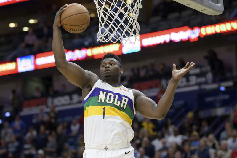 FILE - In this Feb. 13, 2020, file photo, New Orleans Pelicans forward Zion Williamson grabs a rebound during the first half of an NBA basketball game against the Oklahoma City Thunder in New Orleans. The marketing agent who has sued NBA rookie Williamson wants the former Duke star to answer questions about whether he received improper benefits before playing his lone season with the Blue Devils. (AP Photo/Matthew Hinton, File)