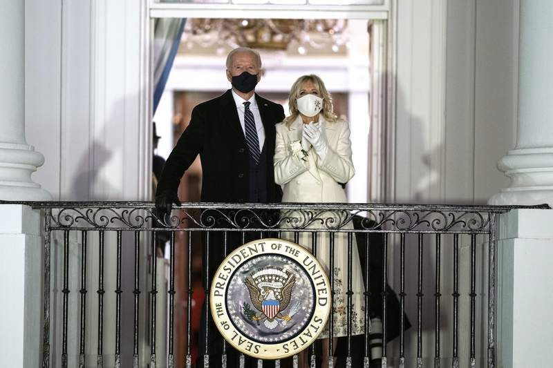 FILE - In this Wednesday, Jan. 20, 2021, file photo, President Joe Biden and first lady Jill Biden watch fireworks from the White House, in Washington. An interview with the Bidens appears in the Feb. 15, 2021, issue of People magazine, hitting newsstands nationwide Friday, Feb. 5. (AP Photo/Evan Vucci, File)