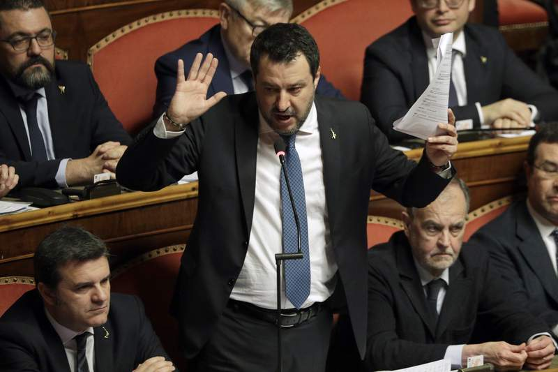 FILE - In this Feb. 12, 2020 file photo, then opposition leader Matteo Salvini speaks at the end of the debate at the Italian Senate on whether to allow him to be prosecuted, as he demands to be, for alleging holding migrants hostage for days aboard coast guard ship Gregoretti instead of letting them immediately disembark in Sicily, while he was interior minister, in Rome. An Italian prosecutor on Saturday, April 10, 2021 told a court that there's no reason to order right-wing leader Salvini to stand trial for alleged kidnapping for his role in keeping rescued migrants aboard a coast guard ship for days in summer 2019. (AP Photo/Andrew Medichini, file)