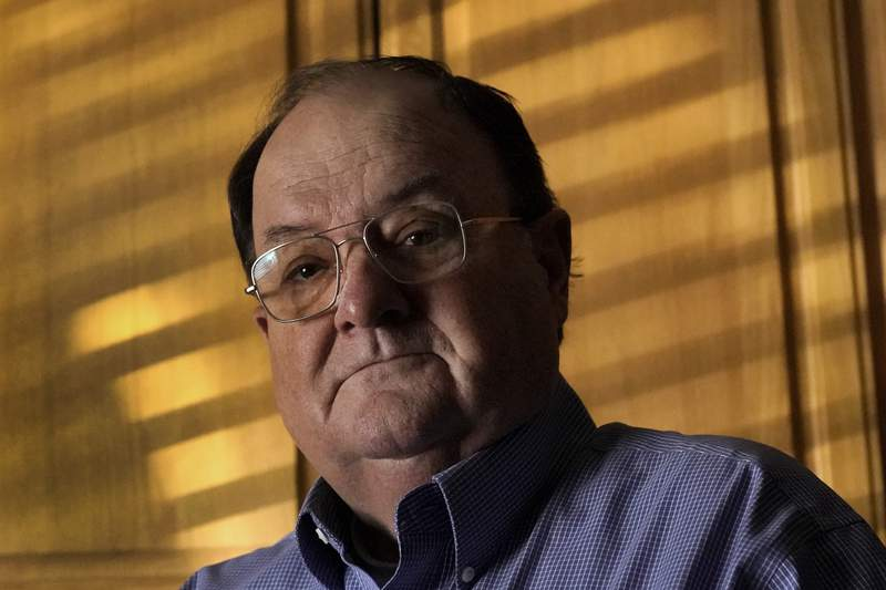 Mortuary owner Brian Simmons reflects on the experience of loosing his daughter Rhonda Ketchum, who died before Christmas of COVID-19, Thursday, Jan. 28, 2021, in Springfield, Mo. Simmons has been making more trips to homes to pick up bodies to be cremated and embalmed since the pandemic hit. For many families, home is a better setting than the terrifying scenario of saying farewell to loved ones behind glass or during video calls amid the coronavirus pandemic. (AP Photo/Charlie Riedel)