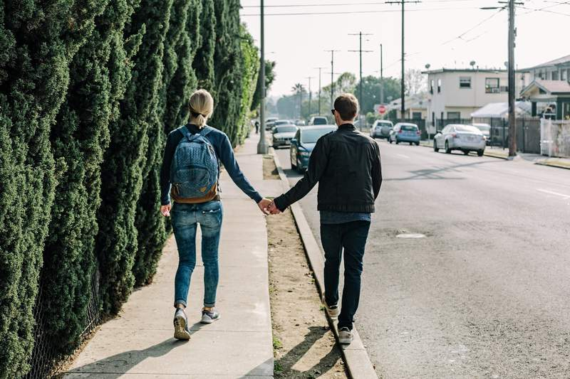 Stock image of a couple holding hands