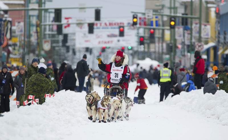 FILE -  In this March 3, 2018, file photo, musher Aliy Zirkle runs her team during the ceremonial start of the Iditarod Trail Sled Dog Race in Anchorage, Alaska. There has been another dramatic change to the worlds most famous sled dog race this year because of the pandemic, with officials announcing Friday, Feb. 5, 2021, that the ceremonial start has been canceled. (AP Photo/Michael Dinneen, File)