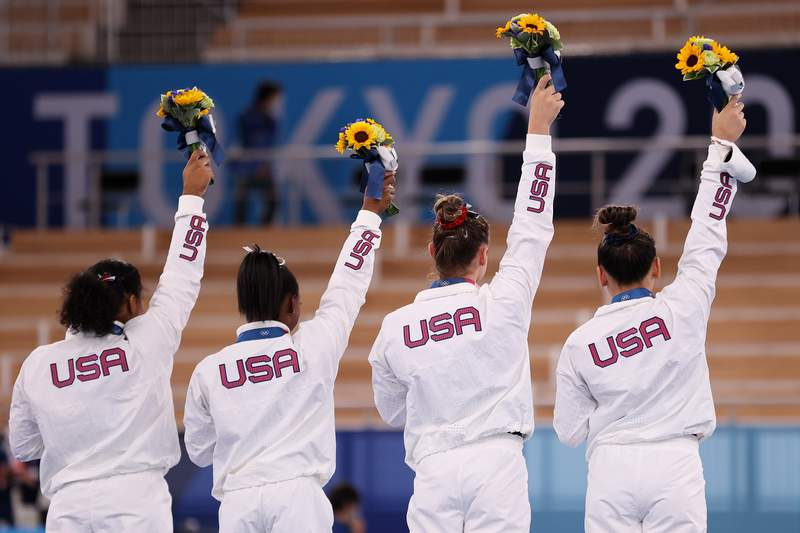 TOKYO, JAPAN - JULY 27: Jordan Chiles, Simone Biles, Grace McCallum and Sunisa Lee of Team United States react on the podium after winning the silver medal during the Women's Team Final on day four of the Tokyo 2020 Olympic Games at Ariake Gymnastics Centre on July 27, 2021 in Tokyo, Japan. (Photo by Laurence Griffiths/Getty Images)