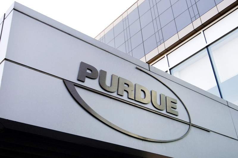 FILE - This Tuesday, May 8, 2007, file photo shows the Purdue Pharma logo at its offices in Stamford, Conn. Purdue Pharma, the company that makes OxyContin, the powerful prescription painkiller that experts say helped touch off an opioid epidemic, will plead guilty to three federal criminal charges as part of a settlement of over $8 billion, Justice Department officials told The Associated Press. (AP Photo/Douglas Healey, File)