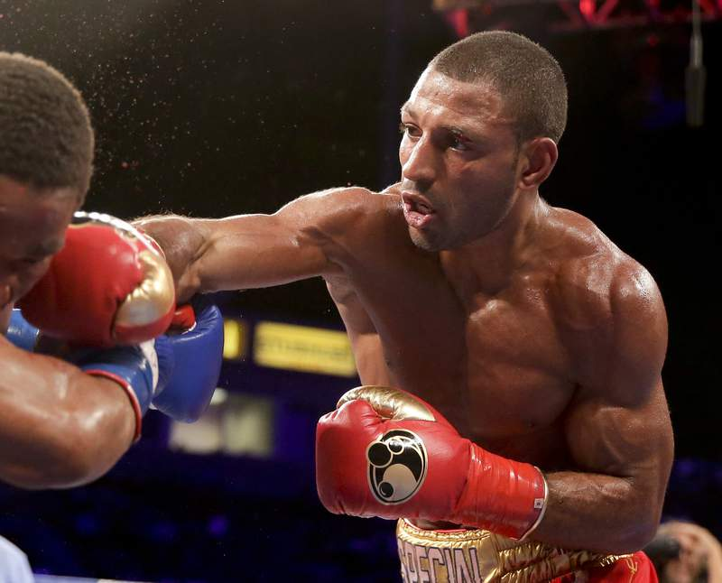 FILE - In this Aug. 16, 2014, file photo, Kell Brook, right, hits Shawn Porter during their IBF welterweight title boxing bout in Carson, Calif. Brook, who fought at 160 pounds when he was stopped in the fifth round by Golovkin in 2016, said he started losing weight early for this fight so he wouldnt have to starve himself late. But there are questions not only about him coming down in weight but also the wear and tear hes had in his years in the ring. At the age of 34, it could be his final hurrah if he cant come up with the performance of a lifetime against Crawford. (AP Photo/Chris Carlson, File)
