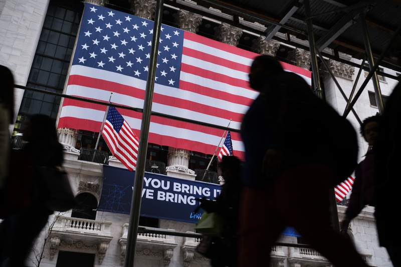 NEW YORK, NEW YORK - FEBRUARY 12: People walk past the New York Stock Exchange (NYSE) on February 12, 2020 in New York City. The market closed up over 250 points as gains in tech companies and retailers outweighed concerns over the coronavirus. (Photo by Spencer Platt/Getty Images)