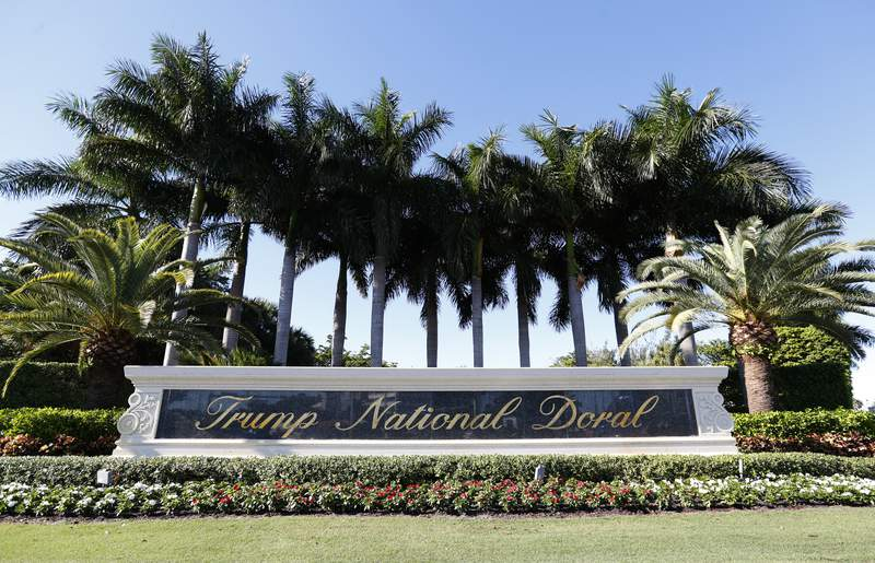 In this Nov. 20, 2019 photo, the entrance to the Trump National Doral resort is shown in Doral, Fla. The Trump golf resort in South Florida where President Donald Trump initially wanted to host this year's Group of Seven summit has temporarily laid off over 500 workers. (AP Photo/Wilfredo Lee)