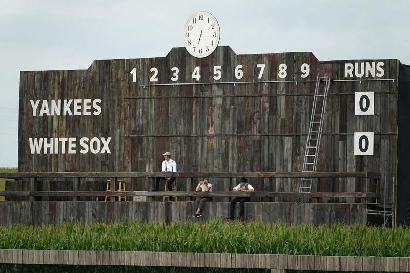 The scoreboard is shown in the outfield during a baseball game between the New York Yankees and Chicago White Sox, Thursday, Aug. 12, 2021 in Dyersville, Iowa.
