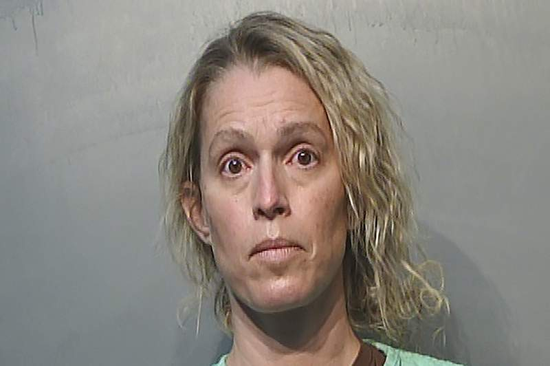 This Jan. 21, 2021, photo provided by the Polk County Jail in Des Moines, Iowa shows Jennifer Woodley. Former Make-A-Wish Iowa CEO Jennifer Woodley is charged with first-degree theft and unauthorized use of a credit card. The organization announced last summer that she had been terminated as CEO after it discovered financial irregularities during a compliance review. (Polk County Jail via AP)