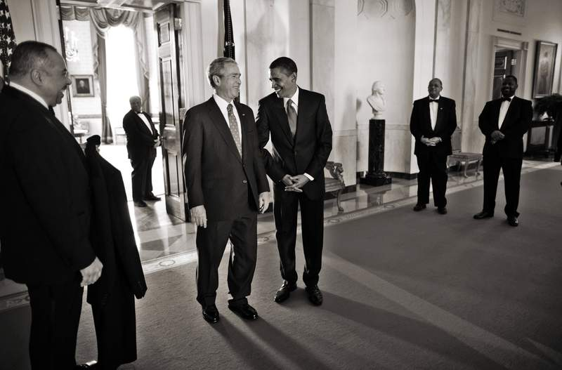 President-elect Barack H. Obama and President George W Bush share a laugh before they leave the White House to go on route to the capitol for the Inauguration.