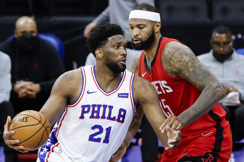 PHILADELPHIA, PENNSYLVANIA - FEBRUARY 17: Joel Embiid #21 of the Philadelphia 76ers drives to the basket past DeMarcus Cousins #15 of the Houston Rockets during the third quarter at Wells Fargo Center on February 17, 2021 in Philadelphia, Pennsylvania. NOTE TO USER: User expressly acknowledges and agrees that, by downloading and or using this photograph, User is consenting to the terms and conditions of the Getty Images License Agreement. (Photo by Tim Nwachukwu/Getty Images)