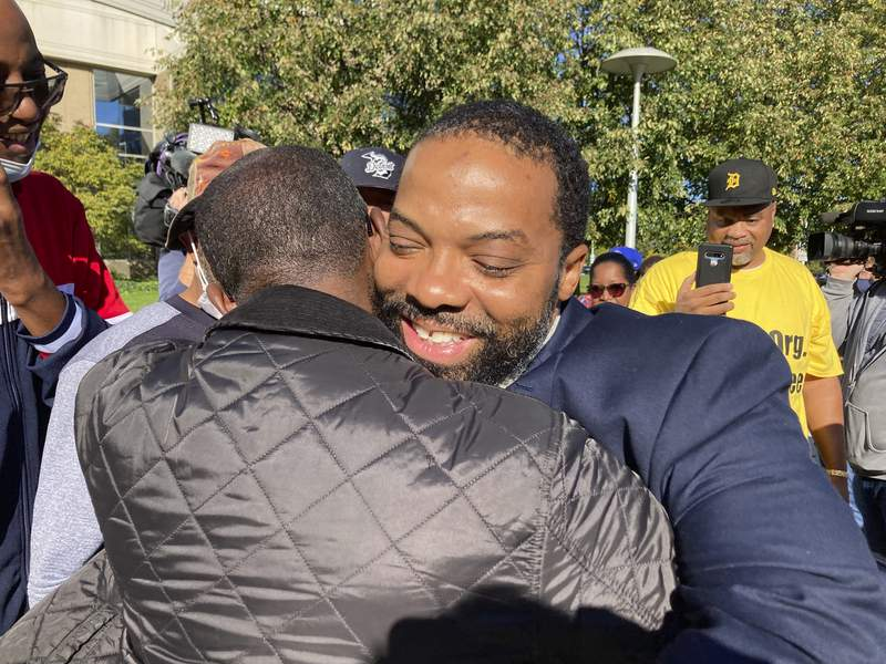 Juwan Deering gets a hug outside the courthouse in Pontiac, Michigan, on Thursday, Sept. 30, 2021, after murder charges were dropped in a fire that killed five children in suburban Detroit in 2000. Deering served 15 years in prison. Oakland County prosecutor Karen McDonald said Deering was the victim of misconduct by law enforcement when he was charged and convicted in 2006. (AP Photo/Ed White)