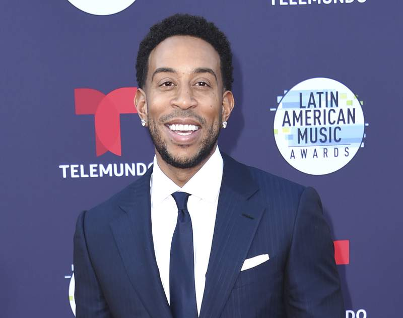 """FILE - Ludacris arrives at the Latin American Music Awards in Los Angeles on Oct. 25, 2018. The rapper-actor stars in Luda Can't Cook,"""" a one-hour special that debuts Feb. 25 on the discovery+ plus streaming service. He gets schooled by chef Meherwan Irani, who introduces him to international flavors and techniques. (Photo by Richard Shotwell/Invision/AP, File)"""