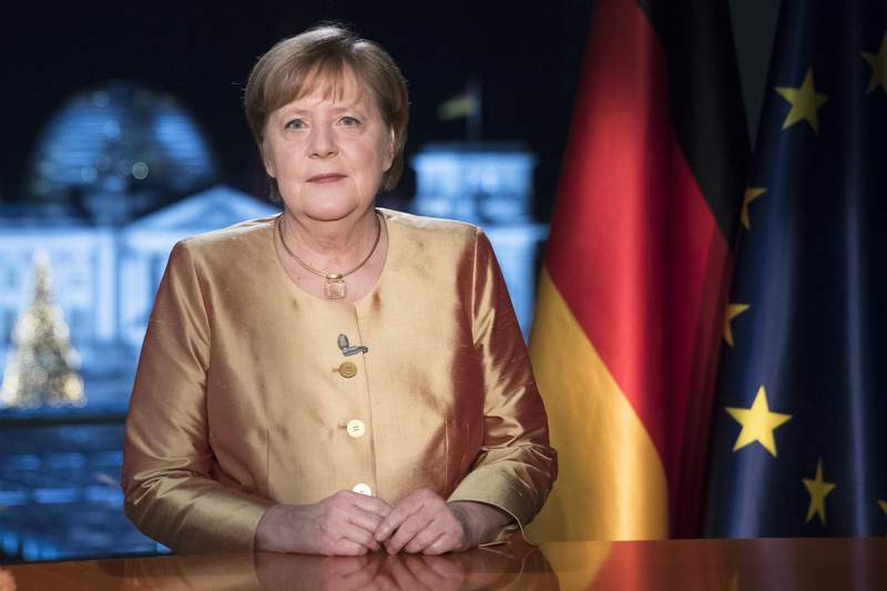 FILE - In this Dec. 30, 2020 file photo German Chancellor Angela Merkel poses for photographs after the television recording of her annual New Year's speech at the chancellery in Berlin, Germany. The coronavirus pandemic is colliding with politics as Germany embarks on its vaccination drive and one of the most unpredictable election years in its post-World War II history. (AP Photo/Markus Schreiber, File)