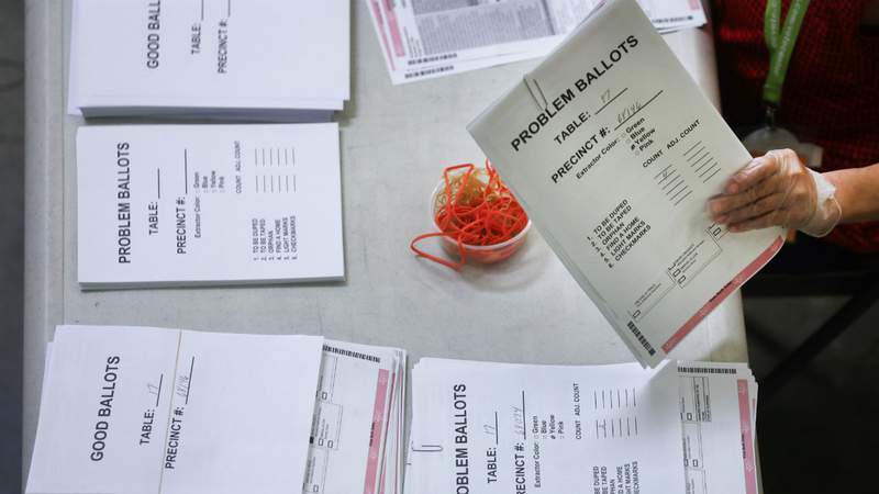 An election worker processes mail-in ballots at the Orange County Registrar of Voters on October 19, 2020 in Santa Ana, California. Photo by Mario Tama.