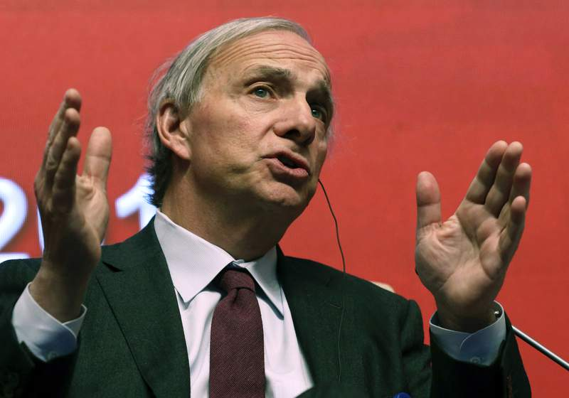 FILE - In this March 23, 2019 file photo, Bridgewater Associates Chairman Ray Dalio speaks during the Economic Summit held for the China Development Forum in Beijing, China. A family spokesperson says the 42-year-old son of hedge fund founder Ray Dalio died in a car crash this week. The family spokesperson on Friday, Dec. 18, 2020 confirmed Devon Dalio's death in a Thursday afternoon crash to Hearst Connecticut Media.  (AP Photo/Ng Han Guan, File)