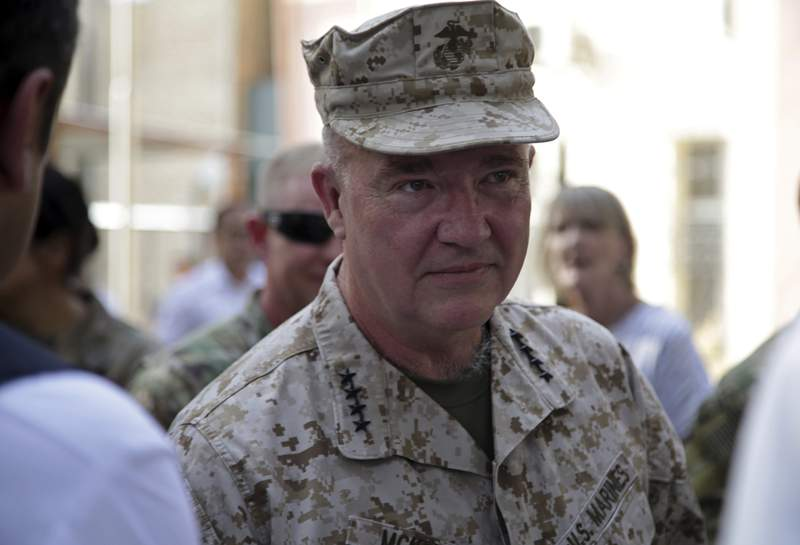 """Marine Gen. Frank McKenzie, the head of U.S. Central Command, attends at a ceremony where Gen. Scott Miller, who has served as Americas top commander in Afghanistan since 2018, handed over command, at Resolute Support headquarters, in Kabul, Afghanistan, Monday, July 12, 2021. The United States is a step closer to ending a 20-year military presence that became known as its """"forever war,"""" as Taliban insurgents continue to gain territory across the country. (AP Photo/Ahmad Seir)"""