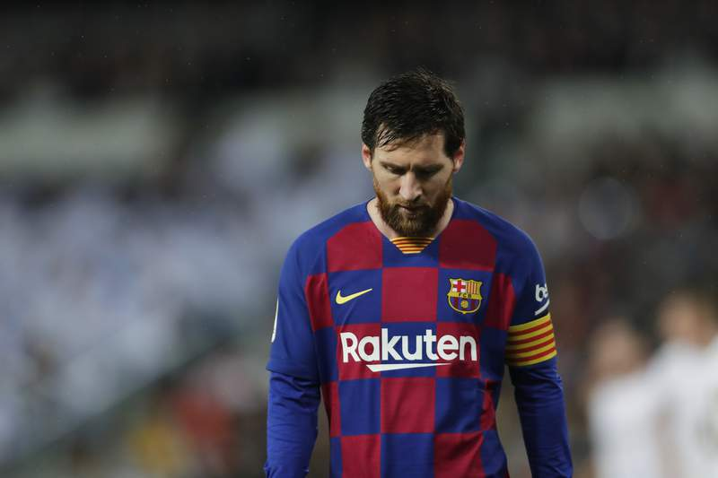 Barcelona's Lionel Messi reacts during the Spanish La Liga soccer match between Real Madrid and Barcelona at the Santiago Bernabeu stadium in Madrid, Spain, Sunday, March 1, 2020. (AP Photo/Manu Fernandez)