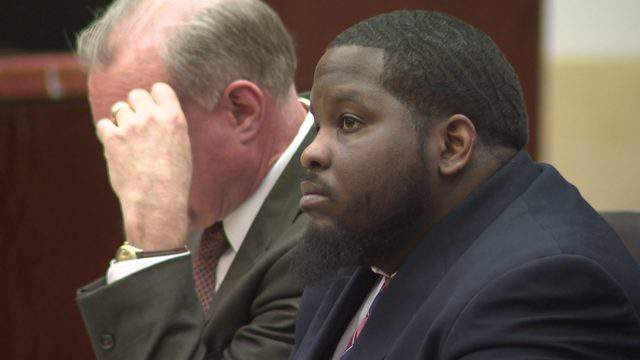 Dante Moore listens to proceedings in a Houston courtroom at his murder trial on March 6, 2019.