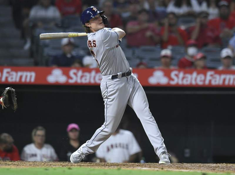 Houston Astros' Jake Meyers hits a grand slam in the sixth inning against the Los Angeles Angels during a baseball game Saturday, Aug 14, 2021, in Anaheim, Calif. (AP Photo/John McCoy)