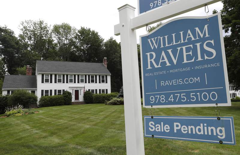 FILE - In this July 22, 2019, file photo a sale pending sign stands in front of a house in North Andover, Mass. On Tuesday, Oct. 29, the National Association of Realtors releases its September report on pending home sales, which are seen as a barometer of future purchases. (AP Photo/Elise Amendola, File)