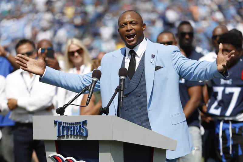 FILE - Former Tennessee Titans running back Eddie George speaks as his number 27 is retired during a halftime ceremony at an NFL football game between the Titans and the Indianapolis Colts in Nashville, in this Sunday, Sept. 15, 2019, file photo. Tennessee State has hired former NFL running back Eddie George as the new NCAA college football coach, banking on his name and football connections to revive the program. TSU introduced George at a news conference Tuesday, April 13, 2021.  (AP Photo/Wade Payne, File)