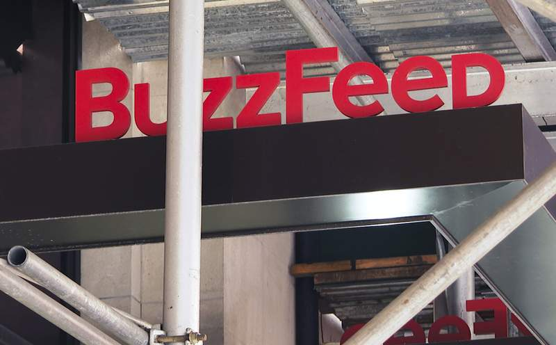 FILE - The entrance to BuzzFeed in New York is seen on Nov. 19, 2020. Buzzfeed announced that it has laid off 45 reporters, editors and producers from the newly acquired HuffPost. The dismissals come three weeks after Buzzfeed acquired HuffPost from Verizon Media. (AP Photo/Ted Shaffrey, File)