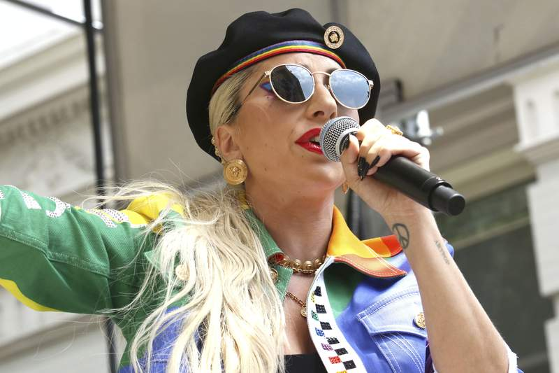 FILE - This June 28, 2019 file photo shows Lady Gaga performing in the second annual Stonewall Day honoring the 50th anniversary of the Stonewall riots, hosted by Pride Live and iHeartMedia in New York. Officials say Lady Gagas dog walker was shot and her two French bulldogs stolen in Hollywood during an armed robbery. Los Angeles police are seeking two suspects, thought its not known if both were armed, in connection with the Wednesday night shooting. (Photo by Greg Allen/Invision/AP, File)