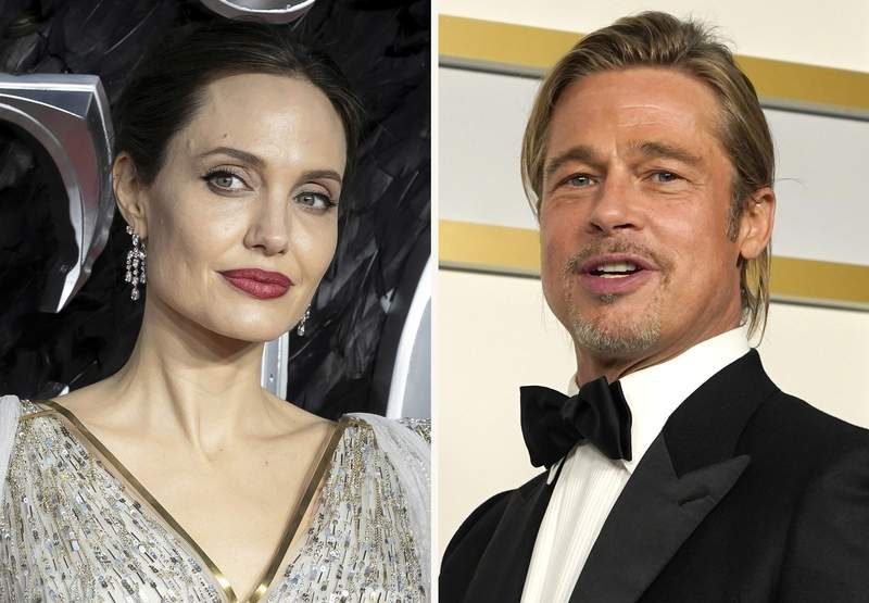 """In this combination photo, Angelina Jolie, left, arrives at the European Premiere of """"Maleficent Mistress of Evil"""" in central London on Oct. 9, 2019, and Brad Pitt poses in the press room at the Oscars on April 25, 2021, in Los Angeles. A California appeals court on Friday, July 23, 2021, disqualified a private judge being used by Angelina Jolie and Brad Pitt in their divorce case, handing Jolie a major victory. The 2nd District Court of Appeal agreed with Jolie that Judge John Ouderkirk didn't sufficiently disclose business relationships with Pitt's attorneys. The decision means that the custody fight over the couple's five minor children, which was nearing an end, could be starting over. (AP Photo)"""