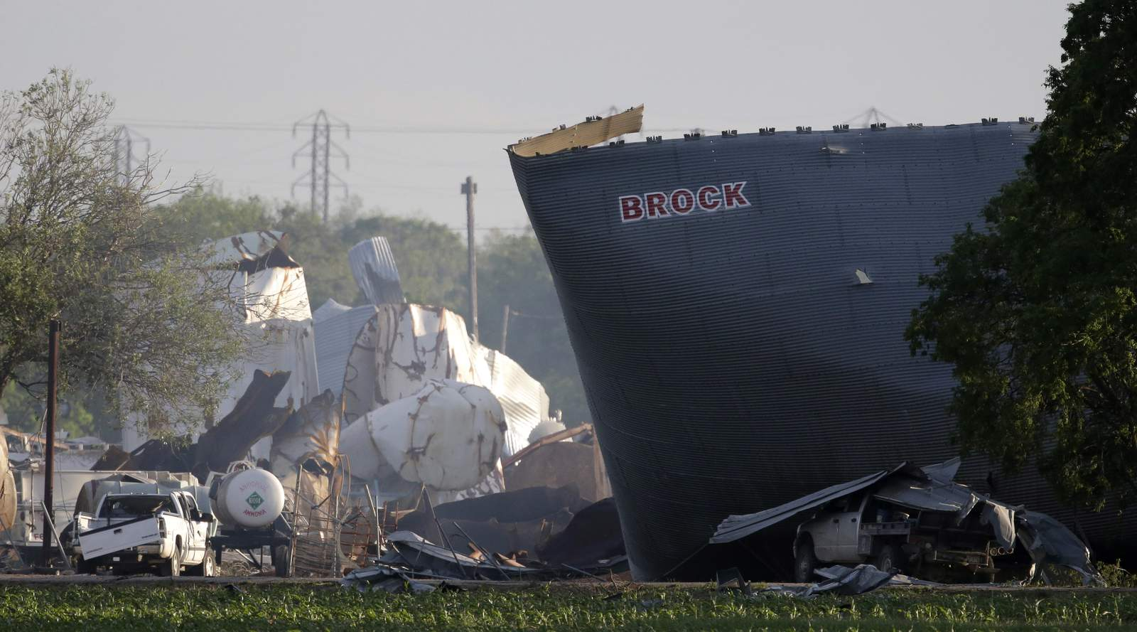 """FILE - In this April 18, 2013 file photo, mangled debris of the West Fertilizer Co. plant is seen, a day after an explosion leveled the plant in West, Texas. Images of a massive explosion in the Lebanese capital looked depressingly familiar to West, Texas Mayor Tommy Muska, whose small town in 2013 was partly leveled by one of the deadliest fertilizer plant explosions in U.S. history. """"I don't know what people were thinking about storing that stuff,"""" Muska said, Wednesday, Aug. 5, 2020. (AP Photo/Charlie Riedel, File)"""