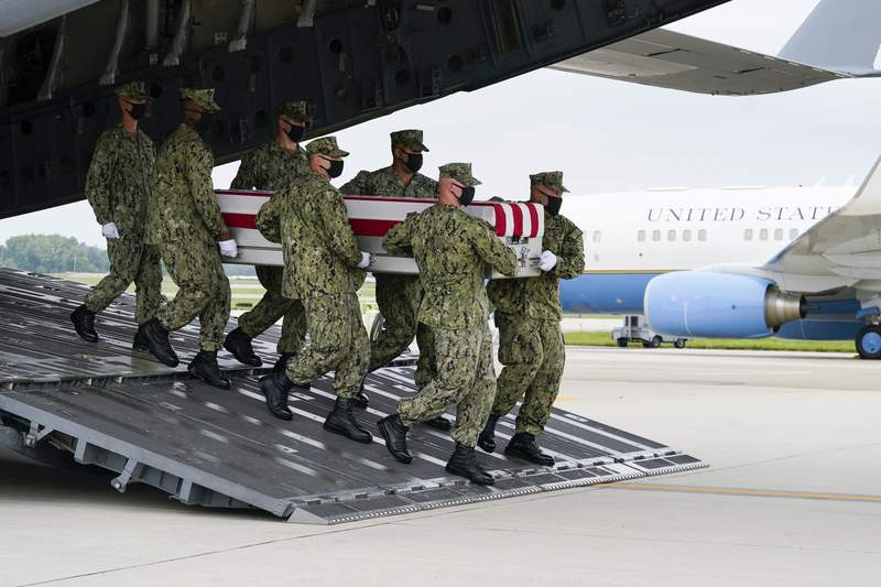 A Navy carry team moves a transfer case containing the remains of Navy Corpsman Maxton W. Soviak, 22, of Berlin Heights, Ohio, Sunday, Aug. 29, 2021, during a casualty return at Dover Air Force Base, Del. According to the Department of Defense, Soviak died in an attack at Afghanistan's Kabul airport, along with 12 other U.S. service members supporting Operation Freedom's Sentinel.(AP Photo/Manuel Balce Ceneta)