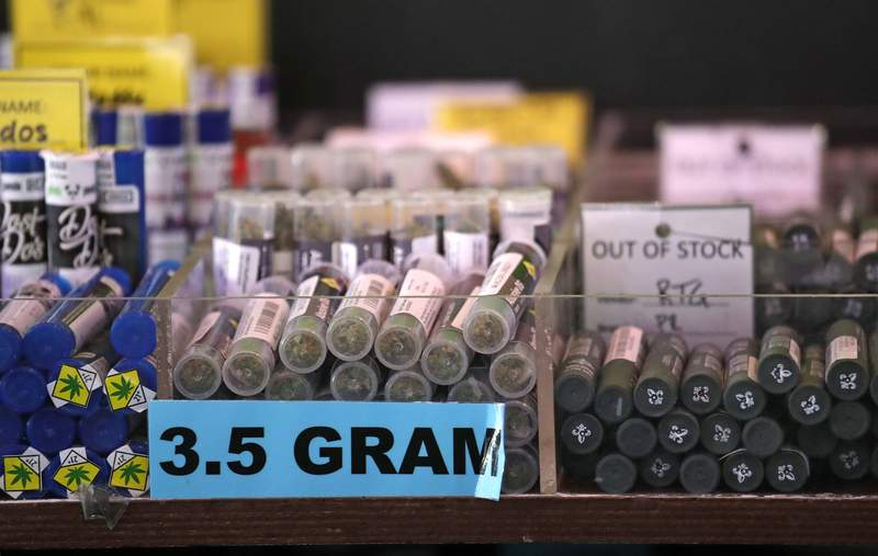 FILE - In this March 28, 2019, file photo, pot products line a display case at a marijuana shop in Seattle. A proposed constitutional amendment that would prevent the legalization of marijuana in Idaho has moved forward as lawmakers in the conservative state try to halt the increasing acceptance of the drug nationwide. The Senate State Affairs Committee voted Wednesday,Jan. 27, 2021, to approve a joint resolution that bans all psychoactive drugs not already legal in Idaho. (AP Photo/Elaine Thompson, File)