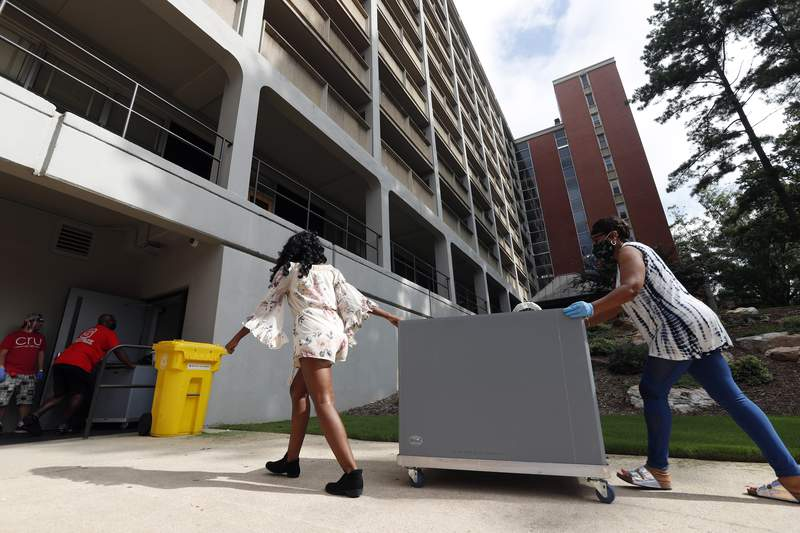 FILE - College students begin moving in for the fall semester at N.C. State University in Raleigh, N.C., Friday, July 31, 2020.  By the end of the U.S. head count last year, the Census Bureau lacked data for almost a fifth of the nation's occupied college dorms, nursing homes and prisons, requiring the statistical agency to make eleventh-hour calls to facilities in an effort to collect resident information or use a last-resort statistical technique to fill in the gaps. (AP Photo/Gerry Broome, file)