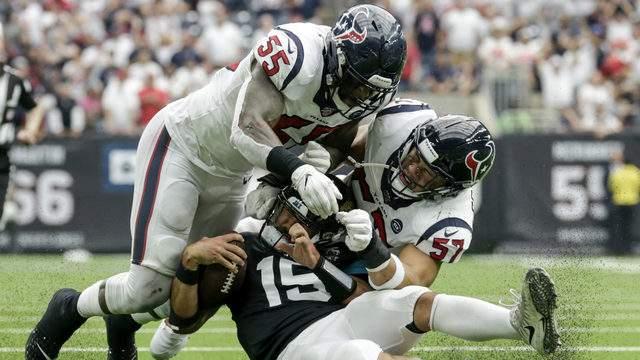 Gardner Minshew #15 of the Jacksonville Jaguars is tackled by Benardrick McKinney #55 of the Houston Texans and Brennan Scarlett #57. (Photo by Tim Warner/Getty Images)