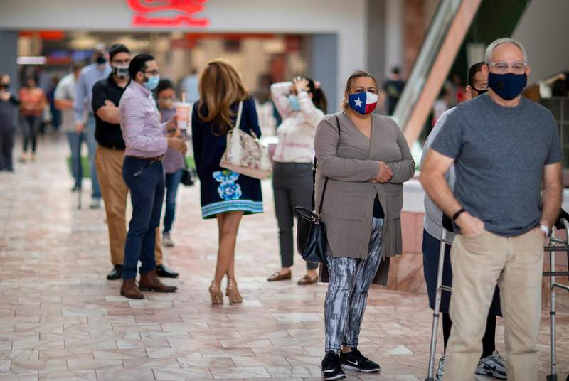 Voters wait in line to cast their ballots on day one of early voting in at the Sunland Park Mall indoor voting site in El Paso on Oct. 13, 2020. (Credit: Ivan Pierre Aguirre for The Texas Tribune)