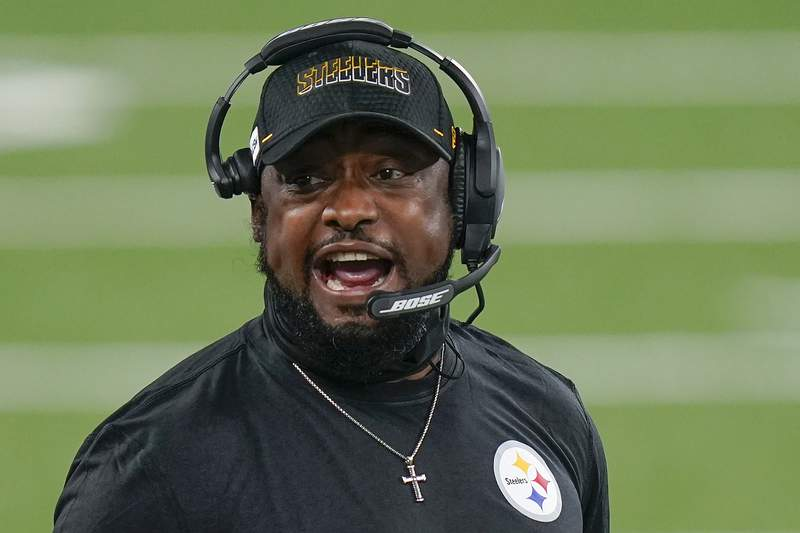 FILE - Pittsburgh Steelers head coach Mike Tomlin talks to players on the sidelines during an NFL football game against the New York Giants in East Rutherford, N.J., in this Monday, Sept. 14, 2020, file photo. The Steelers signed their longtime head coach to a three-year contract extension on Tuesday, April 20, 2021, that runs through the 2024 season. (AP Photo/Seth Wenig, File)